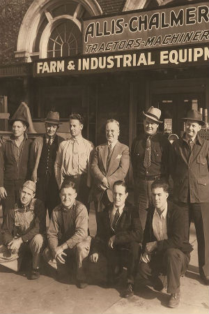 EC Papé in 1938 standing with colleagues in front of Farm & Industrial Equipment store which is now Oregon Electric Station